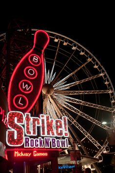 Strike! Rock N' Bowl...Cool Neon Sign with a Ferris Wheel in the background.