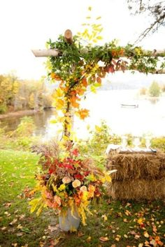 27 Fall Wedding Arches That Will Make You Say 'I Do!'; #1. Bold fall leaves wedding arch