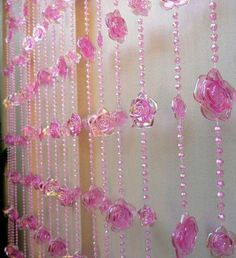 Iridescent pink roses with excellent detail adorn this beaded curtain. There are two sizes of roses on each strand: 1 inches and inch in diameter. There are 23 strands of beads on a wide Beaded Door Curtains, Crystal Curtains, Drapes Curtains, Door Beads, Flower Curtain, Little Girl Rooms, Window Coverings, Beaded Flowers, Crystal Beads