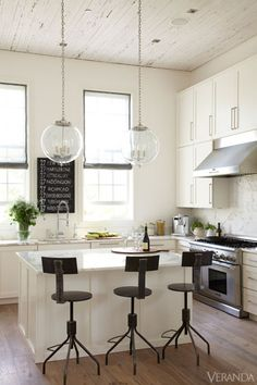 All-white kitchen with industrial lighting