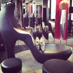 "The 8-foot tall high heel ""couch"" in the lobby of the Hotel Les Jardins de la Villa"