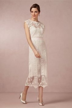 Lilly Dress, Intricate vintage-inspired lace embroidered onto sheer cotton glides to a romantic scalloped hem while a blush sash cinches the waist on this tea-length dress. From Miguelina. Removable grosgrain sash. Pullover styling. Cotton lace; cotton lining. Dry clean. Imported.