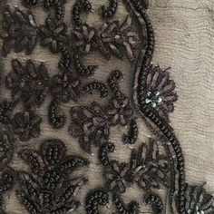 Designing embroidery for our next range of similar dresses.