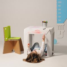 #Wally is a corrugated cardboard table designed for kids, with simple lines and easy to assemble.  Finally, your kid can scribble a table without anyone tell him not to do it. #table #designforkids #kidsbedrooms  http://eco-and-you.com/shop/wally/