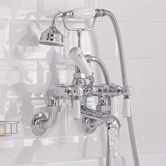 Add stunning traditional style to your bathroom with the Topaz white and chrome bath shower mixer tap Bath Shower Mixer Taps, Bath Taps, Bathroom Taps, Big Bathrooms, Bathroom Inspo, Traditional Bathroom, Traditional Design, Commercial Plumbing, Hudson Reed