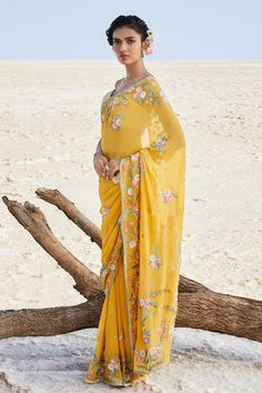 Are you in for a saree this wedding season? Fancy sarees with blouse designs that are stylish are enough to make you a showstopper at any occasion. This list of sarees will guide you on how to wear it right! Indian Wedding Outfits, Indian Outfits, Blouse Art, Saree Blouse, Latest Sarees Online, Gowns Online, Yellow Saree, Simple Sarees, Anita Dongre