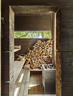 A wood-burning stove from Harvia, of Finland, heats the sauna. The pavilion's rough-cut pine walls are treated with tar, a preservative that yields a time-worn aesthetic.