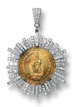 MARIA FELIX, GUADALUPE DIAMOND MEDALLION Suspending a circular medallion with a carving of 'Our Lady of Guadalupe' with inscription 'N.S.D Guadalupe de Mexico. A. 1804, the reverse 'Non Fecit Taliter Omnin Ationi', within a surround of alternating circular and baguette-cut diamond rays, to the diamond-set pendant hoop