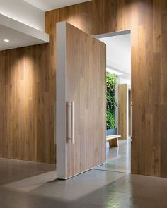 @FeldmanArchitecture's first commercial endeavor maintains a residential feel, courtesy of a European white oak pivoting door that leads to a green wall in reception. 📸: Paul Dyer. @sandow #architecture #interior #design #interiordesign #office #sanfrancisco #california #wood #door