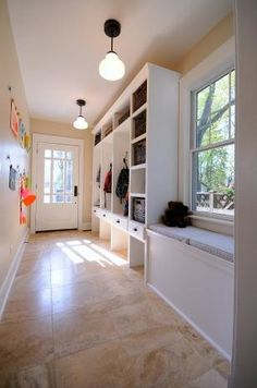 the window seat would look good in our front room. could incorporate shoe bin into storage underneath