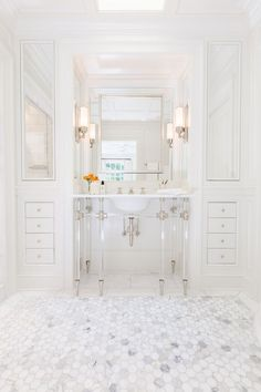 Chic bathroom features a 6 leg nickel and glass washstand topped with marble placed under a satin nickel mirror flanked by floor to ceiling built in cabinets accented with mirrored cabinet doors alongside a marble hexagon tile floor. Chic Bathrooms, Dream Bathrooms, Beautiful Bathrooms, Master Bathrooms, Luxury Interior Design, Home Interior, Bathroom Interior, Bad Inspiration, Bathroom Inspiration