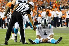 Quarterback Cam Newton (1) of the Carolina Panthers sits on the turf after being knocked down by middle linebacker Todd Davis (51) of the Denver Broncos during the second quarter. The Denver Broncos hosted the Carolina Panthers on Thursday, September 8, 2016.