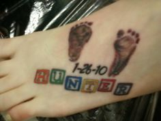 My moms tattoo of her Grandsons footprints on her foot.