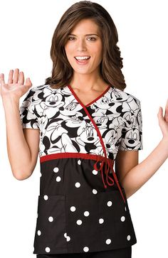This mock wrap scrub top features a solid color bottom with a coordinating print bodice. Also featured are contrast color neck banding, adjustable contrast drawstring waist, back elastic, two patch...