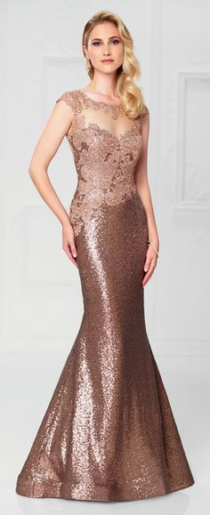Sequin and lace trumpet gown with cap sleeves, lace trimmed illusion bateau neckline, lace appliqué sweetheart bodice with asymmetrically dropped waistline, illusion deep V-back, horsehair hemline.