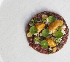 Venison  Tartare  The Musket Room Manhattan, New York  What's it like: This sophisticated dish features uncooked venison sourced from New Zealand, prepared like tartar, and topped with bits of Uni and white raisin