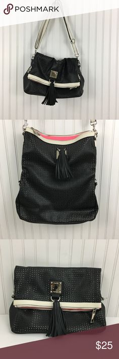 "Mark.  Black Shoulder/cross body/clutch purse Like new Super versatile Mark. Purse. Black perforated vegan leather with cream border.  Can be worn as a shoulder bag, cross body and a clutch. A tassel embellishment can be found on the front.   It has an adjustable shoulder strap.  Neon pink interior.  There is no evidence of wear.  Length: 11"" height folded:9.5"" Height unfolded: 15"" Depth: 4"" mark. Bags Shoulder Bags"