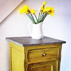 Chalk Paint® in English Yellow and Dark Chalk Paint® Wax make the perfect combination! Annie Sloan Stockist Dovetails Vintage applied Clear and Dark Wax on top of this English Yellow painted side table to create this look. The Dark Wax brings out all the beautiful details.