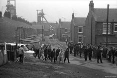 A working miner being escorted through Easington by police. Copyright: Keith Pattison