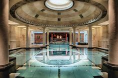 This indoor swimming pool in a London home can disappear and be replaced with a 2400-square-foot dance floor via heavy-duty motors which lift the stone and mosaic tile base of the pool as the water from the pool flows into cisterns underground. [5181  3454]