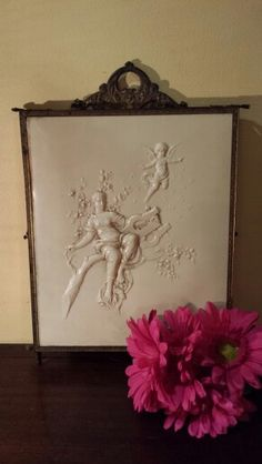 Tri - fold Shaving mirror early 1900's. Hangs on the wall like a photo, then opens up to three mirrors.
