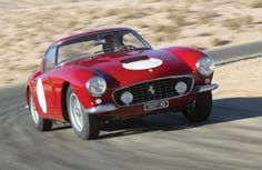 1961 Ferrari 250 SWB below that took first in its class in 1961 and third overall to win the manufacturer's championship for Ferrari.