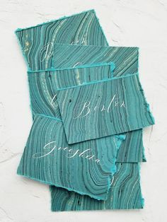 These hand-torn, hand-marbled place cards come in teal, dusty blush, or pale green. Each card has its own unique pattern, and no two cards are exactly alike.