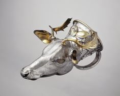 Greek silver rython in form of stag head, classical period, 400 B.C. Allegedly from the region of the Black Sea, provincial Greek work, silver with gilding, 29 cm long. George Ortiz collection