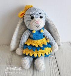 Cute crochet bunny in dress with huge ears, amigurumi, safe toy, dressed bunny