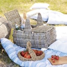 This is one picnic basket you won't find on the high street, with its lovely distinct shape and charming double lid. The basket is made for us on a sturdy metal frame and hand woven in natural kubu that's been steeped in mud to achieve a gorgeous grey wash. It's a wonderfully versatile basket, which you can use long after the picnic season is over to store anything from magazines and toys to loo roll and logs.