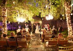 Woodland wedding ceremony backdrop: Soft Lighting Ceremony Decor