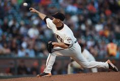 SAN FRANCISCO, CA - JULY 29: Tim Hudson #17 of the San Francisco Giants pitches against the Pittsburgh Pirates in the top of the first inning at AT&T Park on July 29, 2014 in San Francisco, California. (Photo by Thearon W. Henderson/Getty Images)