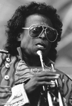 Jazz trumpeter Miles Davis performs onstage at the Newport Jazz Festival in 1990 in Newport, Rhode Island. Get premium, high resolution news photos at Getty Images Newport Jazz Festival, Miles Davis, Jazz Musicians, Still Image, Music Artists, American, Musicians