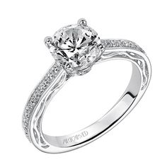 Round cut, and simple... but it's nice. This is also a brand they have at The Diamond Shop.