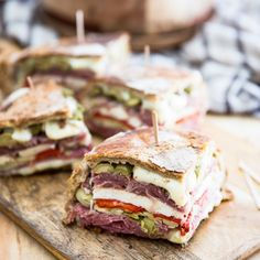 Pretty much everything that you find on a well garnished antipasti plate was stuffed into that muffuletta. I like to think of it as Antipasti in a bread.