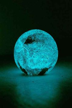 Glass sphere inspired by outer space that glows in the dark to show surface detail.  | UrbanOutfitters.com