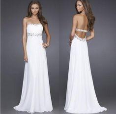 Vestido de novia - VN81 - Realizado en raso italiano y seda. Escote semi-corazón, strapless. Corset drappeado con trabajo de pedrería. Espalda baja con cierre invisible. Corte cintura media. Sin cola.