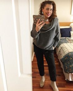 Fee wears black pants and a cowl neck sweater   40plusstyle.com