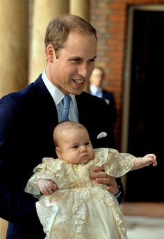 Britain's Prince William carries his son Prince George as they arrive for his son's christening 10-23-13. Click to view more pics and the video. This boy is adorable!
