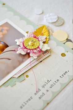 Cute Thread behind button on a flower.. messy brilliance at its best!!