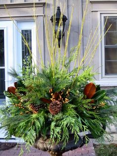 Gorgeous Christmas urns for the holidays add a festive elegance to the entryway and say welcome to your holiday guests. Christmas Urns, Christmas Planters, Christmas Arrangements, Outdoor Christmas Decorations, Winter Christmas, Christmas Home, Christmas Wreaths, Christmas Crafts, Holiday Decor