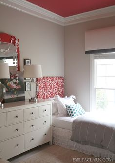"""The Girls' Bedroom: A Window Treatment & A Bedding Update - Emily A. Clark---loving the coral color and the ceiling pops.  How fun~~~ Paint colors used:  Olympic's """"Salsa Diane."""" It's a mix of coral and red.  I painted the walls light gray, using Sherwin William's """"Worldly Gray."""""""