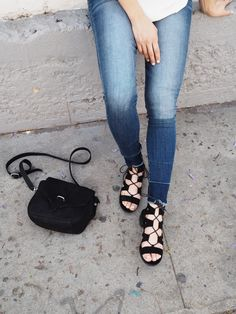 Strappy sandals, simple black purse