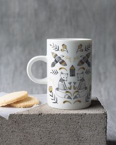Wild Tale Tall Mug - A tall mug is a surefire conversation starter. Enchanting animals and foliage are arranged in harmonious symmetry with golden metallic highlights. Surefire, Conversation Starters, Tumbler, Kitchen Dining, Coasters, Highlights, Metallic, Mugs, Studio