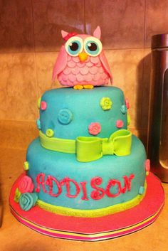 Baby Shower Owl Cake - A cake I made for my cousin's baby shower.  They decorated the nursery in owls, so I pulled some inspiration from there.   The owl topper is made of rice krispies.  Thanks for looking!