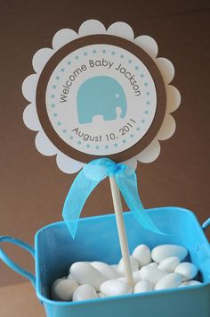 Boy Baby Shower-decoration ideas-use a little basket (or bowl or whatever) in the colors we choose, fill with yogurt covered raisins,or something similar for the tables