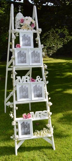 Our vintage ladder is available to hire and comes dressed in a variety of ways. Here is one version. Fill the frames with photos or seating plans. Gorgeous! Available from Scrumdiddly-YUM-ptious. www.candytreescambridge.co.uk Camp Wedding, Rustic Wedding, Our Wedding, Dream Wedding, Wedding Signs, Wedding Ideas, Wedding Table Centres, Wedding Table Centerpieces, Wedding Isle Runner