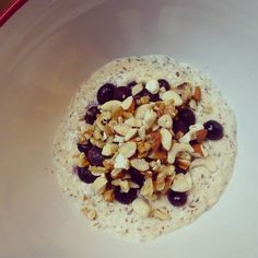 """Oh yes breakfast was simply amazing today! Coconut """"porridge"""" (not an oat in sight!) topped with blueberries and almond cashew and walnuts. Seriously wow my favourite breakfast so far! Going to see if I can share the recipe with you guys because hot damn it's soooooo delicious and really filling. Perfect brekky!"""