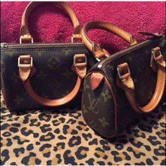 Authentic LV speedy mini. (330 EACH) 2  available Authentic mini speedy. I have 2 available will separate if interested. Both are in almost new condition. Serial numbers are pictured. Please share with friends and family that might be interested. Looking to sell. If making offers please make reasonable offers don't insult. Keep on mind 20% is paid to poshmark. Louis Vuitton Bags Mini Bags