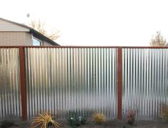 Galvanized metal fence.